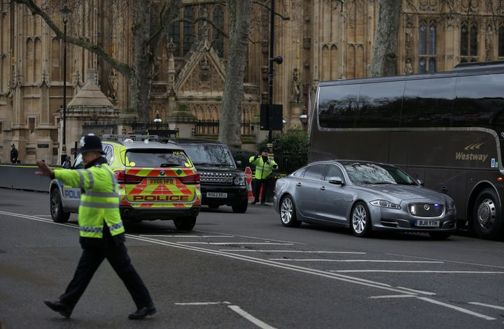 The Jagaur car of Prime Minister Theresa May is driven away from the Houses of Parliament during the incident