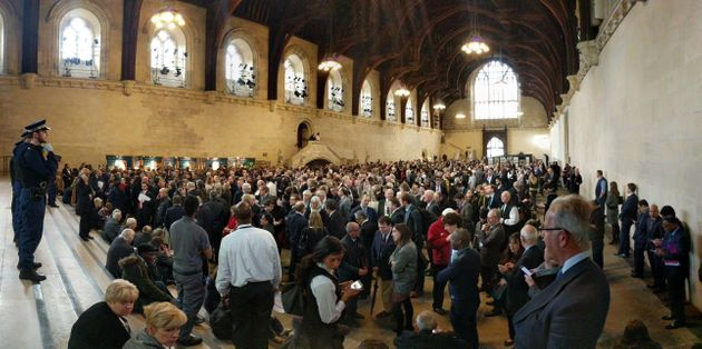 People huddle inside the Houses of Parliament during the security