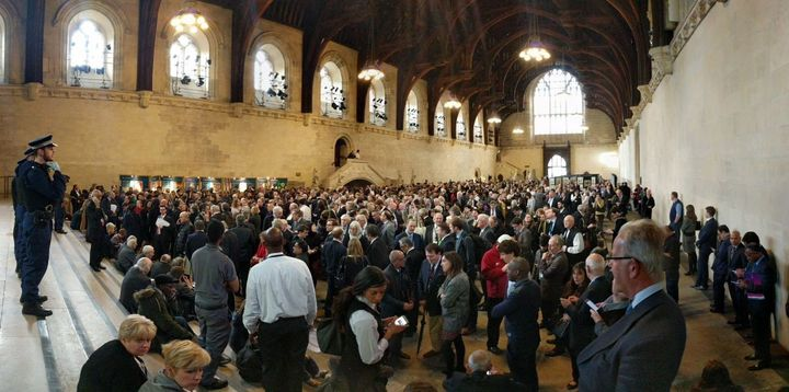 People huddle inside the Houses of Parliament during the security lockdown
