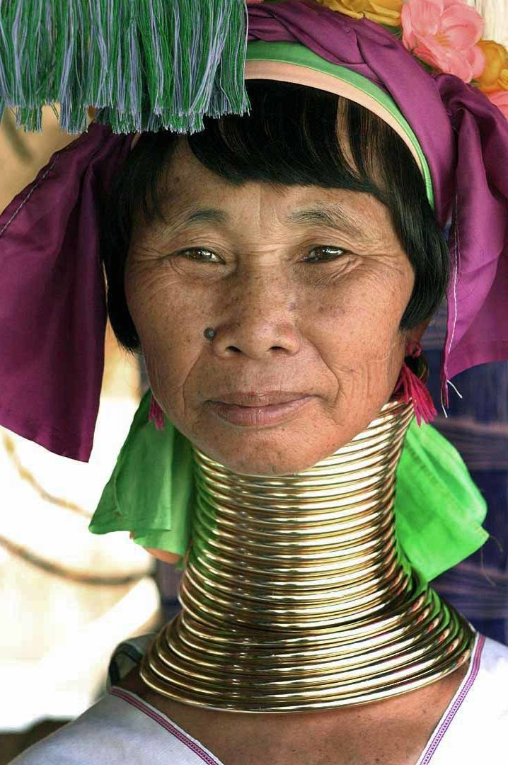 A Kayan woman displays her neck rings.