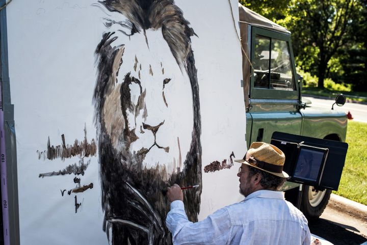 Artist Mark Balma paints a huge mural of Cecil in Dr. Walter Palmer's parking lot on July 29, 2015, at River Bluff Dental in