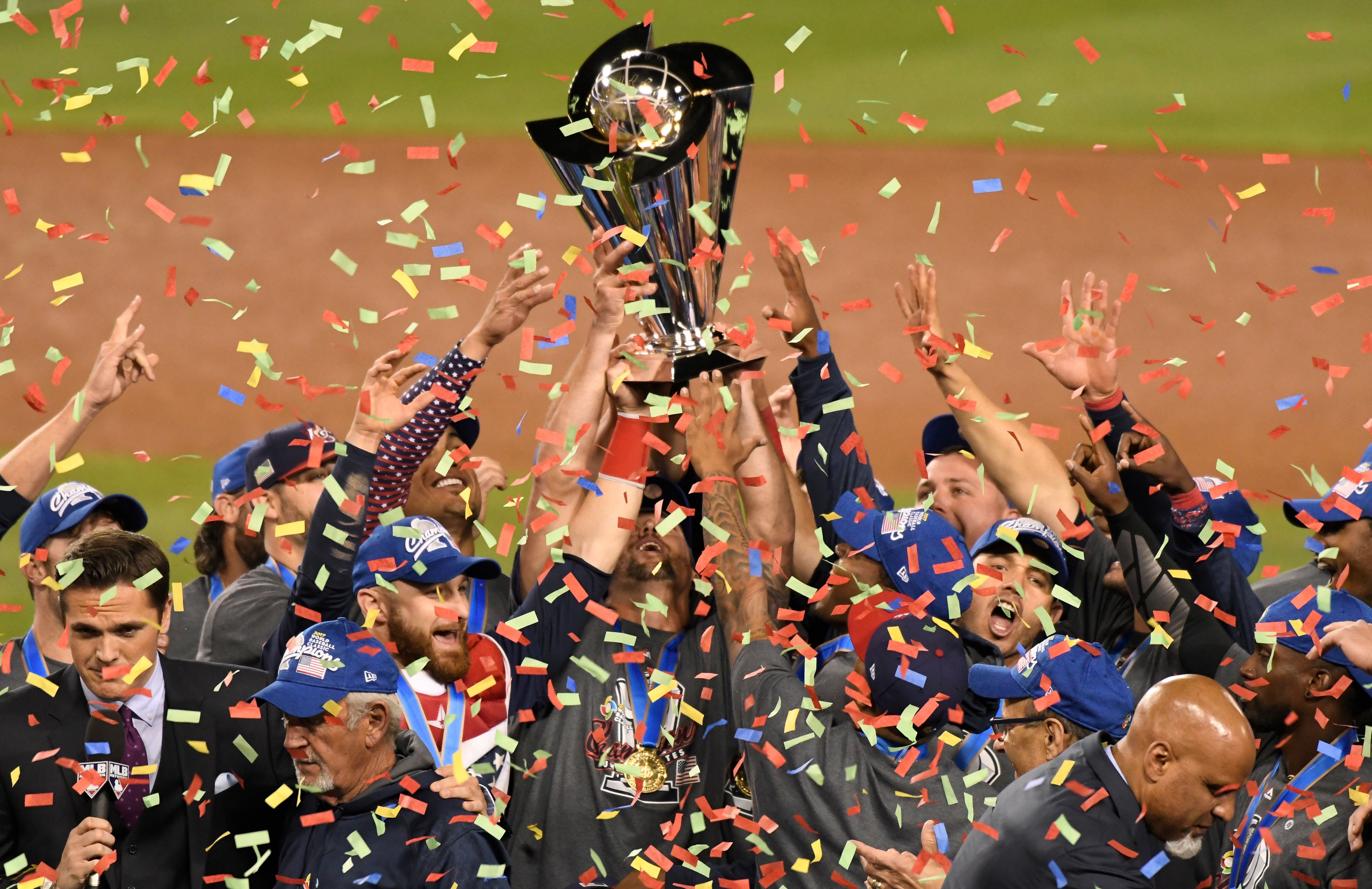 Mar 22, 2017; Los Angeles, CA, USA; United State players hold up the championship trophy after defeating Puerto Rico in the final of the 2017 World Baseball Classic at Dodger Stadium. Mandatory Credit: Robert Hanashiro-USA TODAY Sports