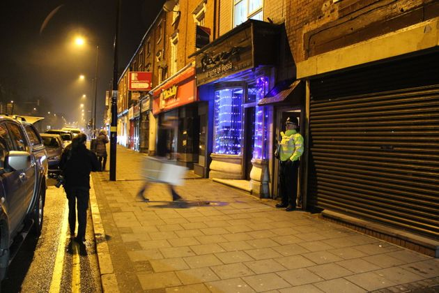 A police officer stand outside an address in Hagley Road, Birmingham, where armed police have raided...