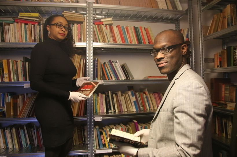 Mitchell Esajas and Jessica de Abreu standing in the soon-to-be launched <em>Black Archives</em>.