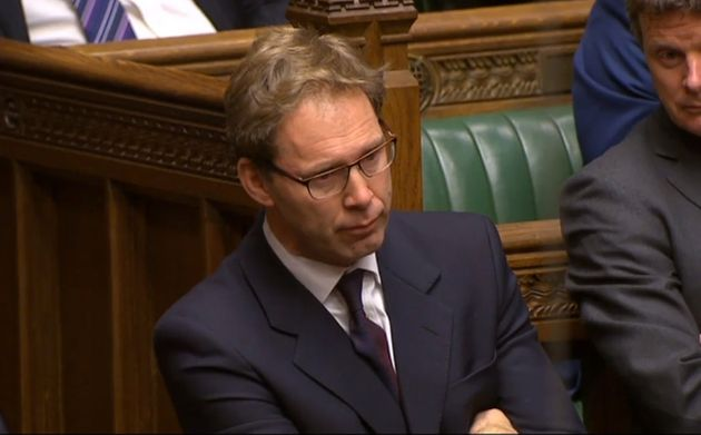 Ellwood listens to Theresa May's praise in the Commons today, as Parliament sat as