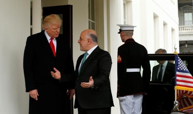 U.S. President Donald Trump greets Iraqi Prime Minister Haider al-Abadi at the White House in Washington, U.S., March 20, 201