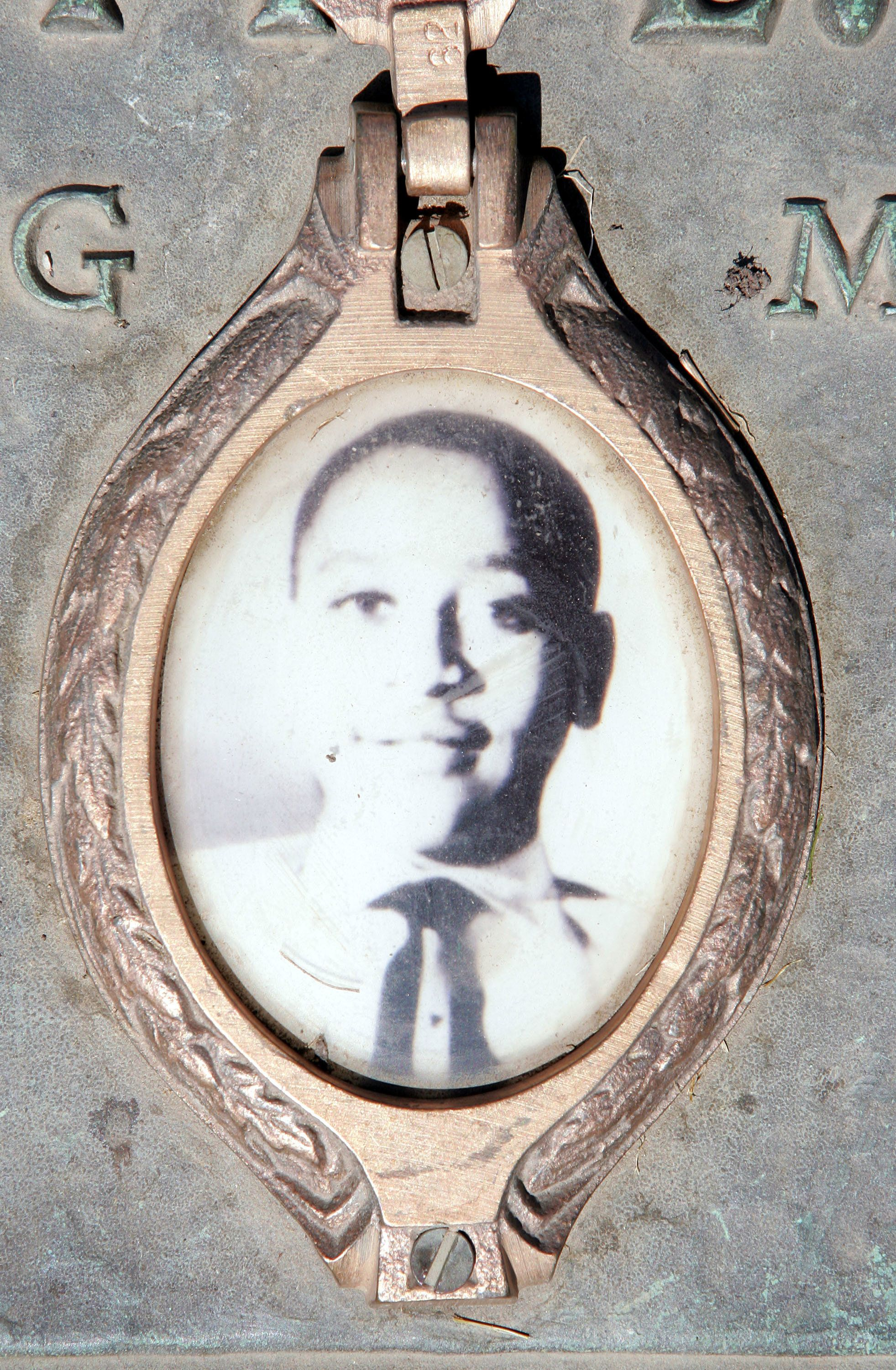 ALSIP, IL - MAY 4:  A photo of Emmett Till is included on the plaque that marks his gravesite at Burr Oak Cemetery May 4, 2005 in Aslip, Illinois. The FBI is considering exhuming the body of Till, whose unsolved 1955 murder in Money, Mississippi, after whistling at a white woman helped spark the U.S. civil rights movement.  (Photo by Scott Olson/Getty Images)
