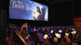 NEW YORK, NY - MARCH 13:  An orchestra performs at the New York special screening of Disney's live-action adaptation 'Beauty and the Beast' at Alice Tully Hall on March 13, 2017 in New York City.  (Photo by Jamie McCarthy/Getty Images for Walt Disney Studios)