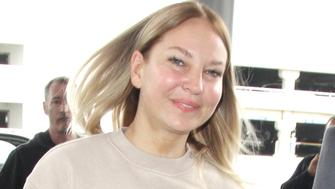 Sia is unmasked as the 41-year-old looks youthful and confident without her trademark wig while catching a flight out of Los Angeles after filing for divorce.  The adorable Australian singer was seen wearing a beige outfit including Kenzo sweats. <P>Pictured: Sia<B>Ref: SPL1466977  220317  </B><BR/>Picture by: Splash<BR/></P><P><B>Splash News and Pictures</B><BR/>Los Angeles:310-821-2666<BR/>New York:212-619-2666<BR/>London:870-934-2666<BR/>photodesk@splashnews.com<BR/></P>