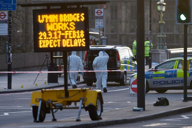 Forensics investigators work at the scene after an attack on Westminster Bridge on