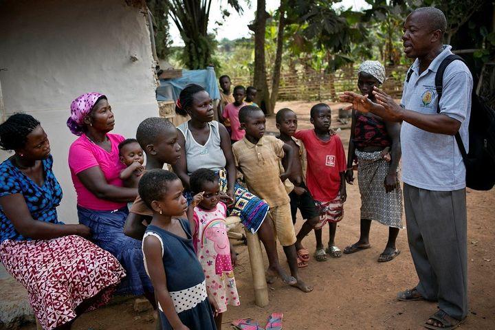 <p><em>A community health volunteer promoting health messages in Ghana.</em></p>