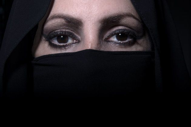 The woman's niqab came away from her face, exposing her and causing pain to her neck (file