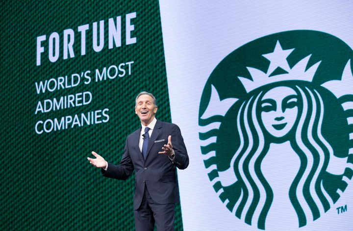 CEO Howard Schultz speaks during the Starbucks annual meeting of shareholders on Wednesday. He's stepping down this month as