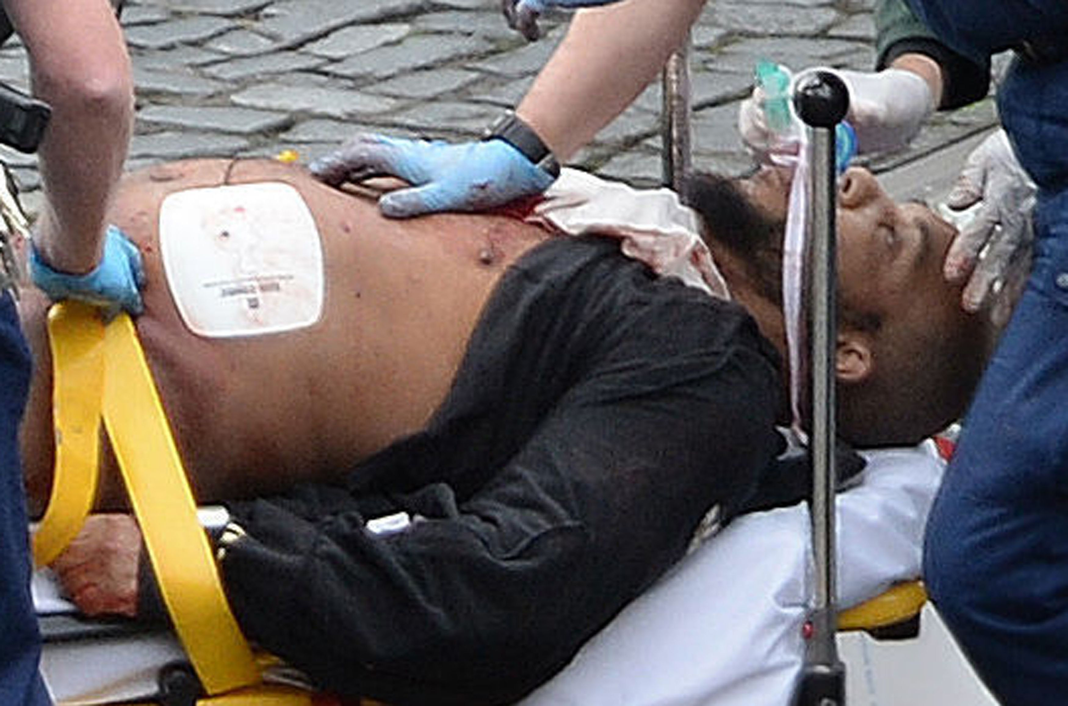 The suspect, since identified as Khalid Masood, is taken away on a stretcher following the