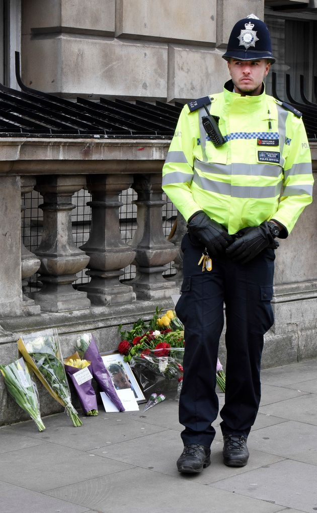 Flowers and a photo of PC Keith Palmer on Whitehall near the Houses of