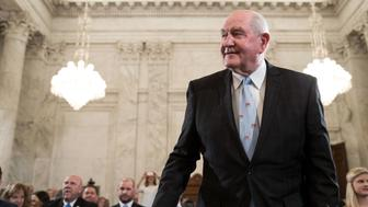 WASHINGTON, DC - MARCH 23: Sonny Perdue, President TrumpÕs nominee to lead the Agriculture Department, takes his seat as he arrives for his confirmation hearing before the Senate Committee on Agriculture, Nutrition, and Forestry on Capitol Hill, March 23, 2017 in Washington. Previously, Perdue served as the governor of Gerogia from 2003 to 2011. (Photo by Drew Angerer/Getty Images)