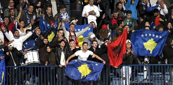 Kosovo fans cheer as their team takes on Finland at a September 2016 football match.