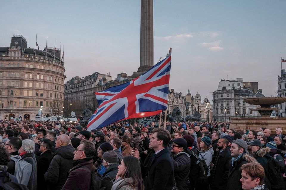 People during a candlelit vigil at Trafalgar Square on March 23, 2017 in London, England.