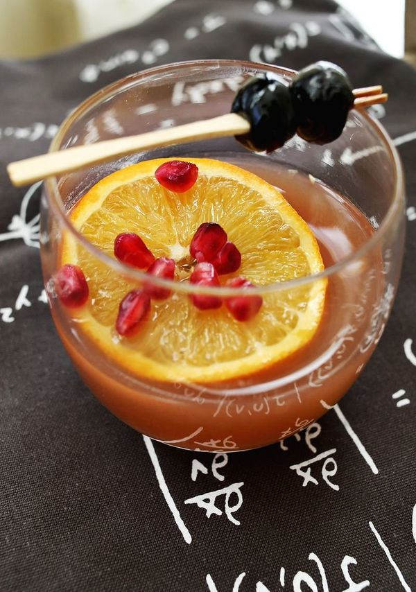 "<strong>Get the <a href=""http://www.abeautifulmess.com/2013/12/winter-fruit-whiskey-smash.html"" target=""_blank"">Orange Pomegr"