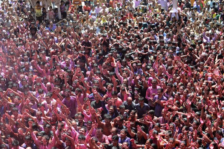 Indian Hindu devotees celebrate the Holi festival at the Swaminarayan Temple in Ahmedabad on March 13, 2017. The Hindu festiv