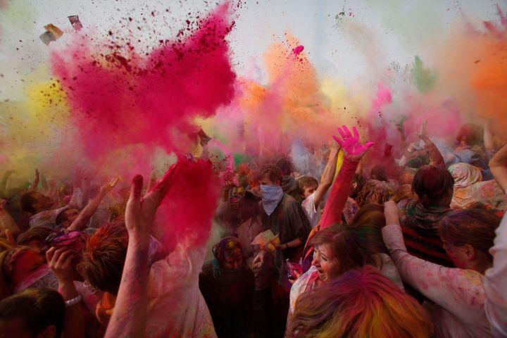 Revellers throw coloured powder during Holi at the Sri Sri Radha Krishna Temple in Spanish Fork, Utah, March 26, 2011.