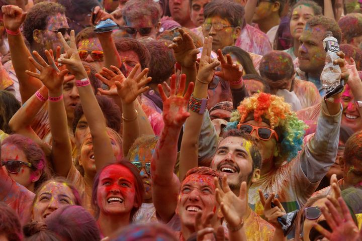 Participants are covered in colored powder as they celebrate in The Color Run in Lima, Peru, August 14, 2016.