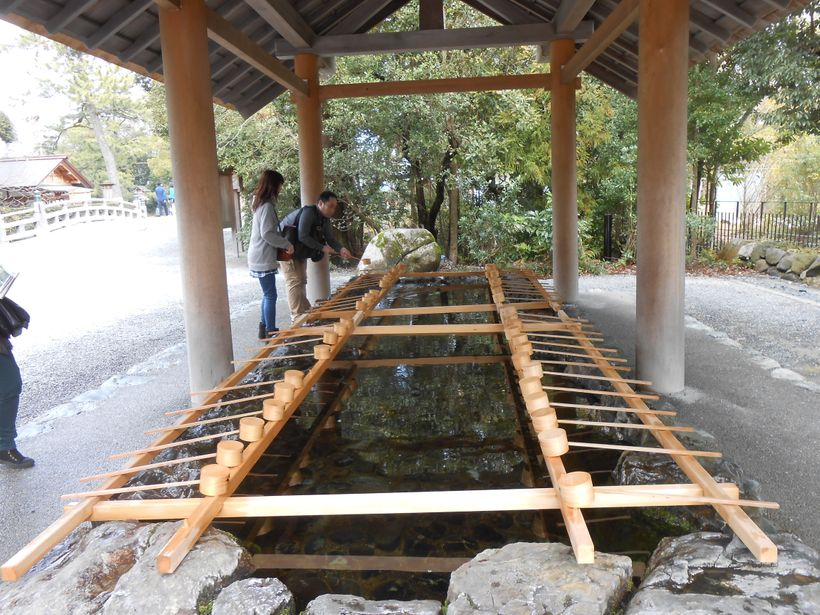 Shinto shrine visitors purify themselves by washing their hands and rinsing their mouth with the pure water.
