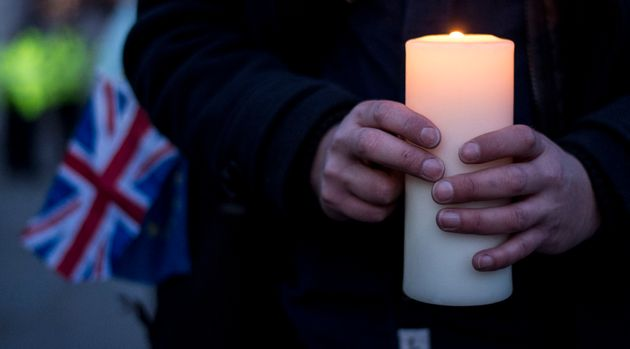 Members of the public during the candlelight vigil in Trafalgar Square to remember those who lost their...