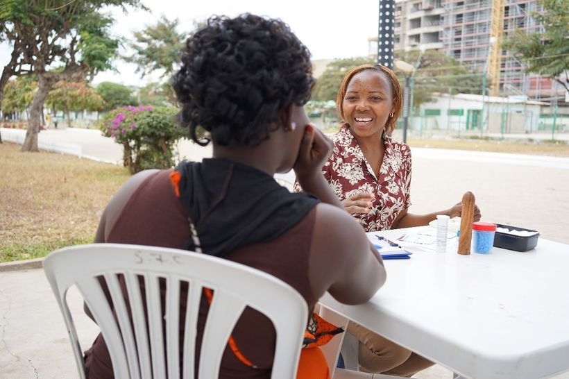 <em>A sex worker in Mozambique receives health information from Zita, a local health counselor.</em>