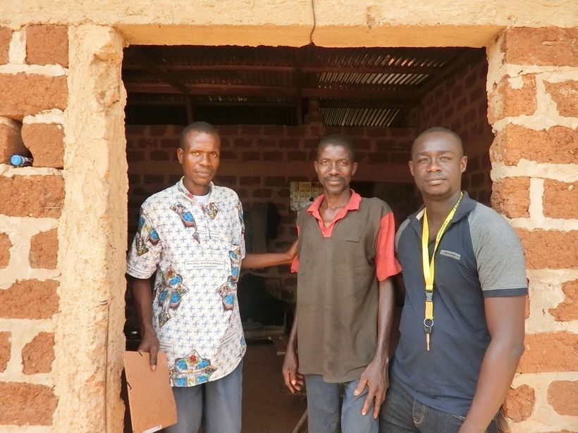 Loukou Kouame with community health workers at his home in Djangokro, Côte d'Ivoire.
