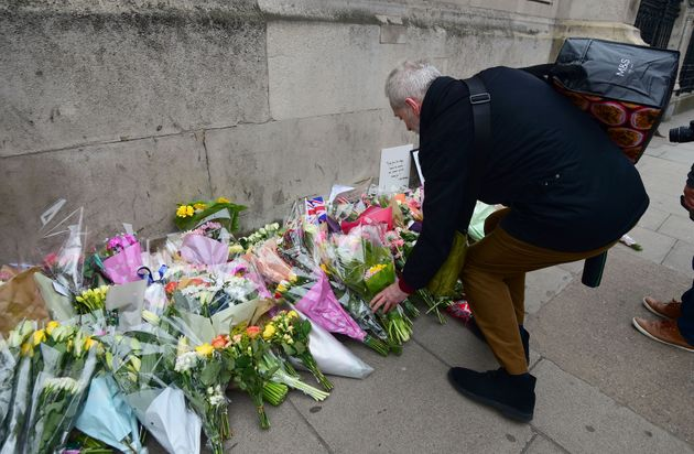 Floral tributes are left outside the Houses of