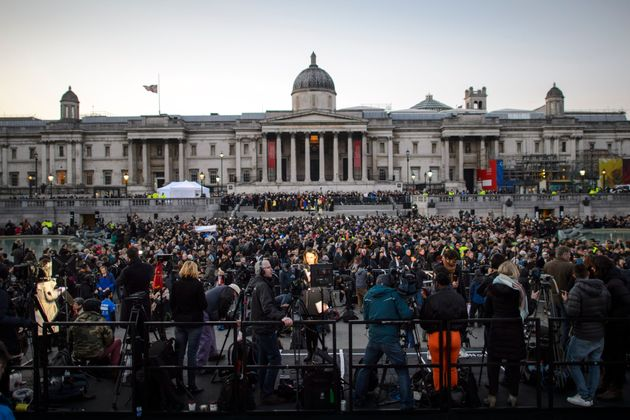 People attending a candlelight vigil in Trafalgar Square to remember those who lost their lives in the