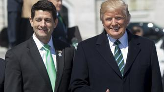 US President Donald Trump waves alongside Speaker of the House Paul Ryan (L) as Trump leaves the Friends of Ireland Luncheon for the visit of Taoiseach of Ireland Enda Kenny at the US Capitol in Washington, DC, March 16, 2017. / AFP PHOTO / SAUL LOEB        (Photo credit should read SAUL LOEB/AFP/Getty Images)