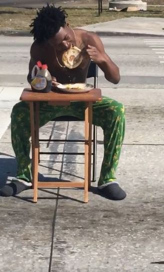 Kiaron Thomas 21 was arrested Tuesday for blocking traffic in Lakeland Florida He was eating pancakes in the middle of the road