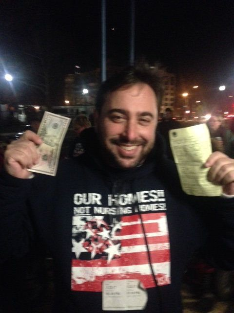 Gregg Beratan holds up money to pay the fine and his summons on Wednesday evening to document his willingness to pay his