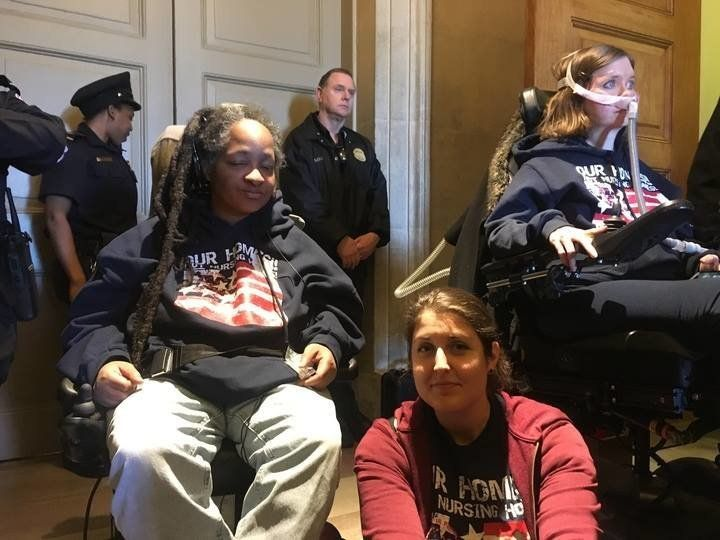ADAPT activists demonstrate in the Capitol rotunda on Wednesday, March 22, 2017.