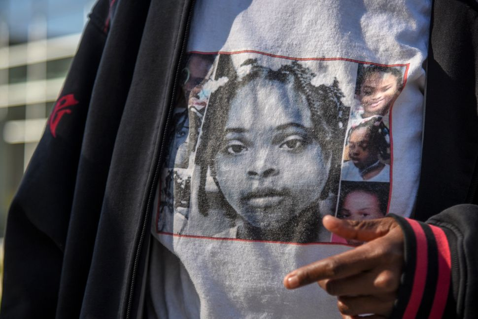 Melissa Young, the grandmother of Relisha Rudd, wears a shirt honoring the missing young girl during acelebration of th