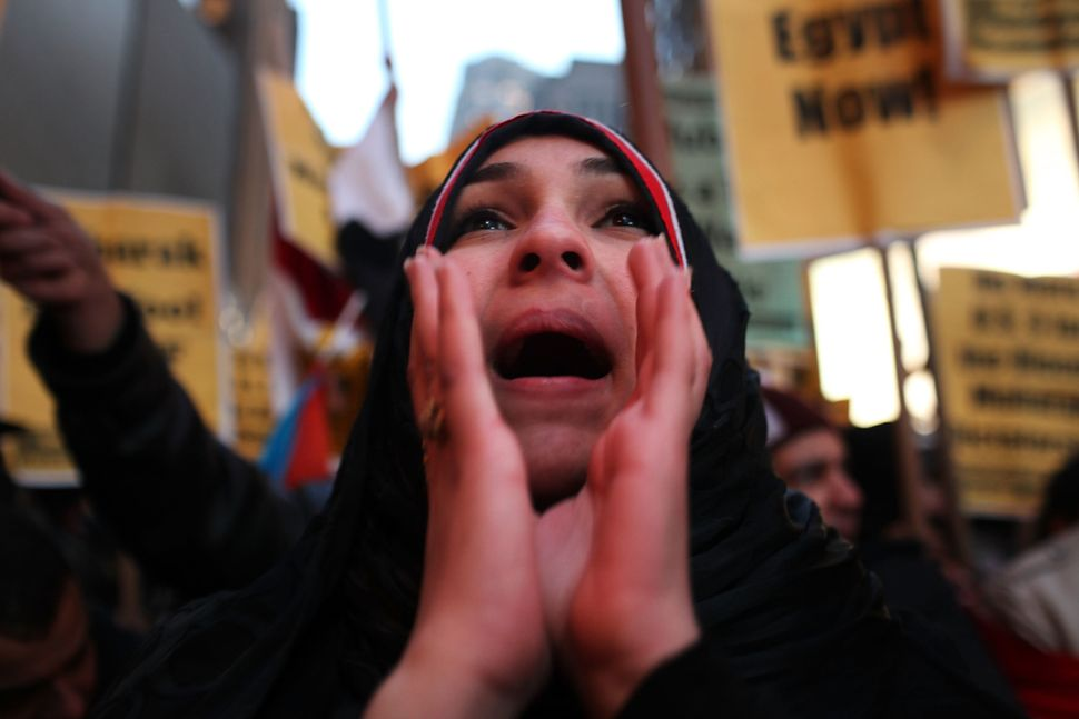 An unidentified woman protests against the regime of Egyptian President Hosni Mubarak in Times Square on Feb. 4, 2011, in New