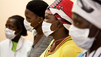 Patients with HIV and tuberculosis (TB) wear masks while awaiting consultation at a clinic in Cape Town's Khayelitsha township, February 23, 2010. In South Africa, 5.5 million people live with HIV/AIDS ? more than in any other country - while 33 million people live with the disease worldwide. In Khayelitsha there is a saying, ?Living with HIV, dying from TB?. The weakened immune system leaves those infected vulnerable to infectious diseases like TB, which spreads easily in Khayelitsha?s poor living conditions and dense population. The TB incidence there is among the highest in the world. REUTERS/Finbarr O'Reilly (SOUTH AFRICA - Tags: HEALTH SOCIETY)