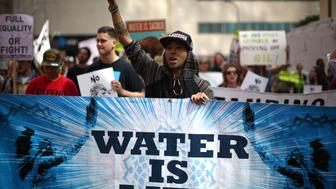 People protest against President Donald Trump's executive order fast-tracking the Keystone XL and Dakota Access oil pipelines in Los Angeles, California, U.S., March 10, 2017. REUTERS/Lucy Nicholson