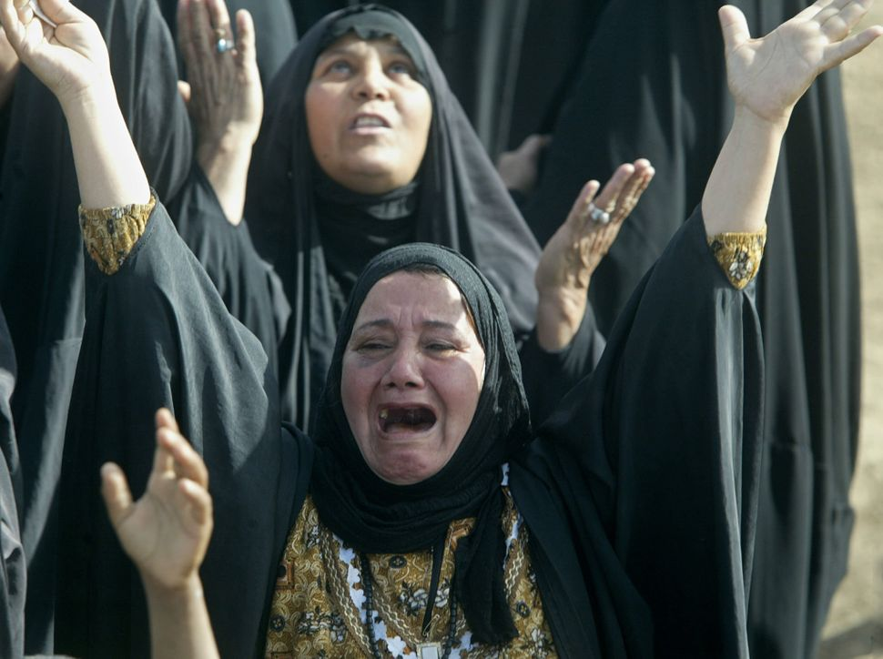 Tearful Iraqi Muslim women protest against the mistreatment of prisoners and demand the release of detainees at the entrance