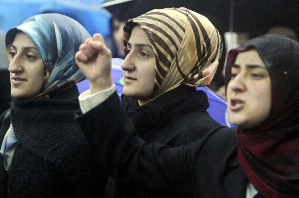 Muslim women demonstrate Jan. 17, 2004, in Berlin during a protest against plans to ban the Islamic headscarf in the German p
