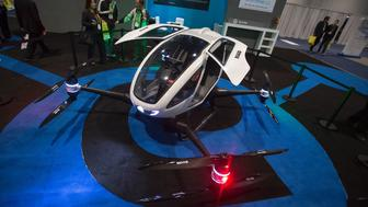 An Ehang 184 autonomous personal helicopter is displayed during the 2017 Consumer Electronic Show (CES) in Las Vegas, Nevada, January 6, 2017. / AFP / DAVID MCNEW        (Photo credit should read DAVID MCNEW/AFP/Getty Images)