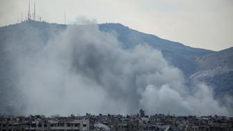 DAMASCUS, SYRIA - MARCH 24 : Smoke rises after the war crafts belonging to the Assad regime forces carried out airstrikes on Cobar region of Damascus, Syria on March 24, 2017.   (Photo by Ammar Suleyman/Anadolu Agency/Getty Images)