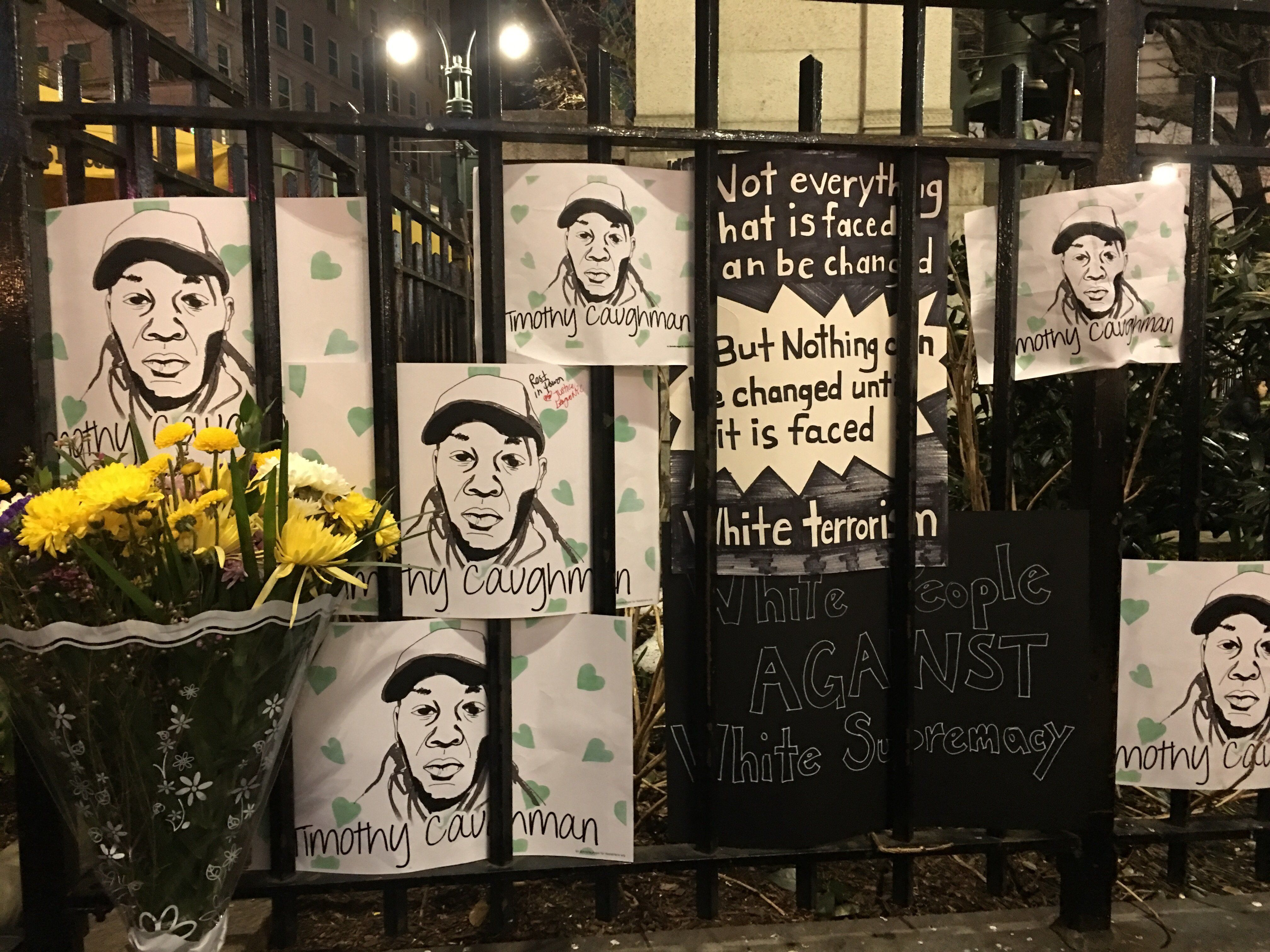 Protesters on Friday night made a makeshift memorial in memory Timothy Caughman -- a black man killed by a white supremacist.