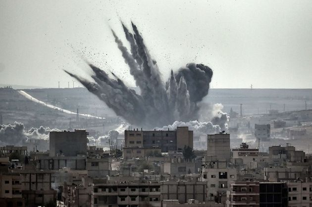 A shell explodes in the Syrian city of
