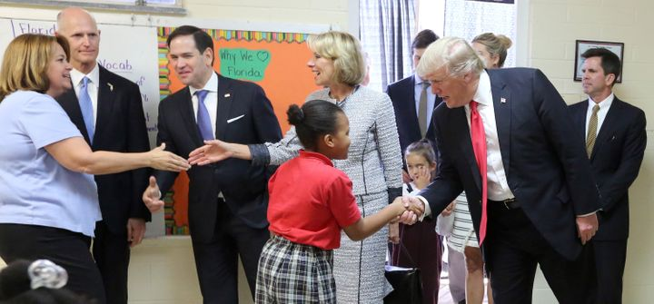 President Donald Trump greets fourth grader Janayah Chatelier on March 3, 2017, in Orlando, Florida.