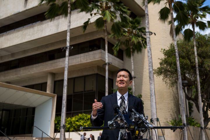 Hawaii State Attorney General Douglas Chin speaks at a press conference in front of the Prince Jonah Kuhio Federal Building a