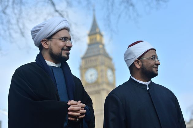 Sheikh Mohammad al Hilli (left) and Sheikh Ezzat Khalifa after a vigil outside Westminster