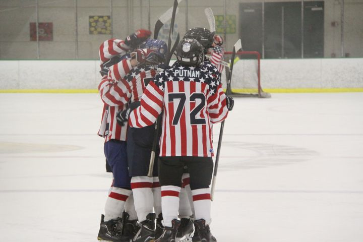 <p>My son and his hockey teammates celebrate a goal.</p>